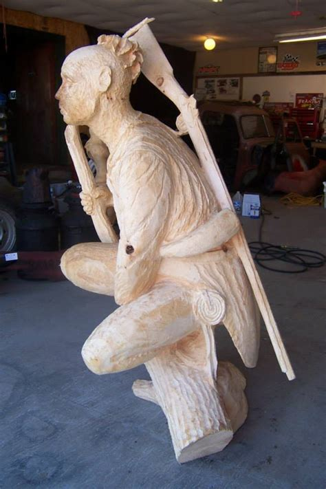 Wooden Sculpture with Chainsaw by Mark Tyoe - XciteFun