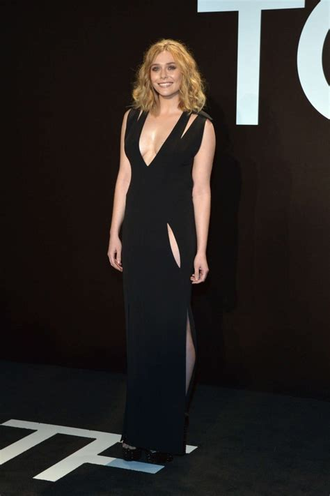 Elizabeth Olsen bares cleavage at the Tom Ford Fall/Winter