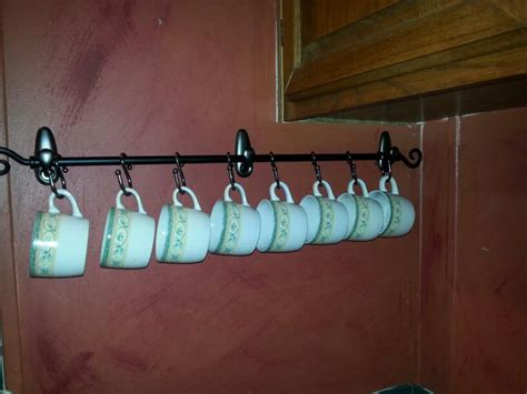 Three Command hooks and a cheap curtain rod plus s-hook