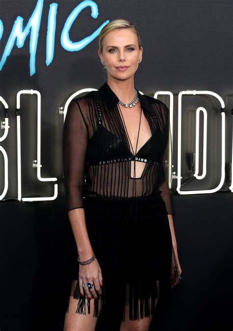 Charlize Theron Photos Photos - Premiere Of Focus Features